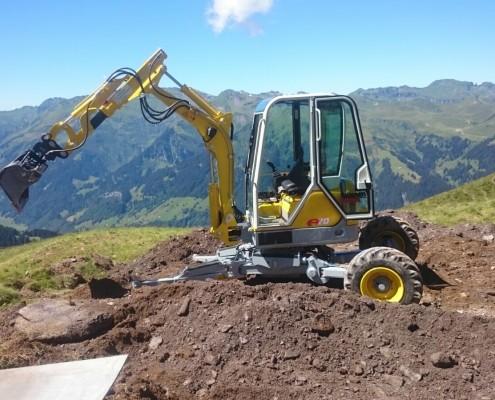 Tiefbauarbeiten auf der Alp